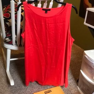 Guava colored sleeveless blouse